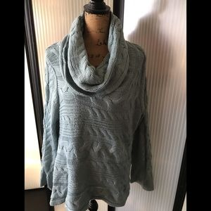 Beautiful monster cowl neck sweater. Machine wash.